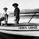 Two men fishing on a boat at Leek's Lodge. Jackson Hole Historical Society and Museum.