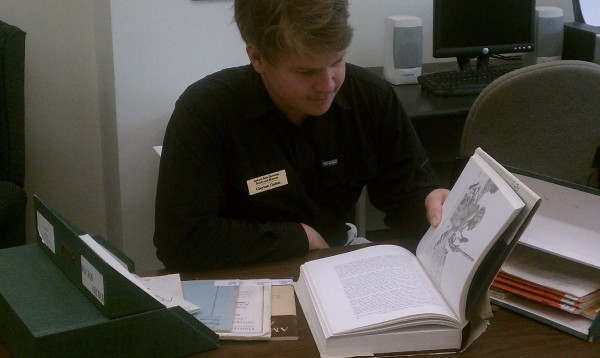 Clayton researching in the library