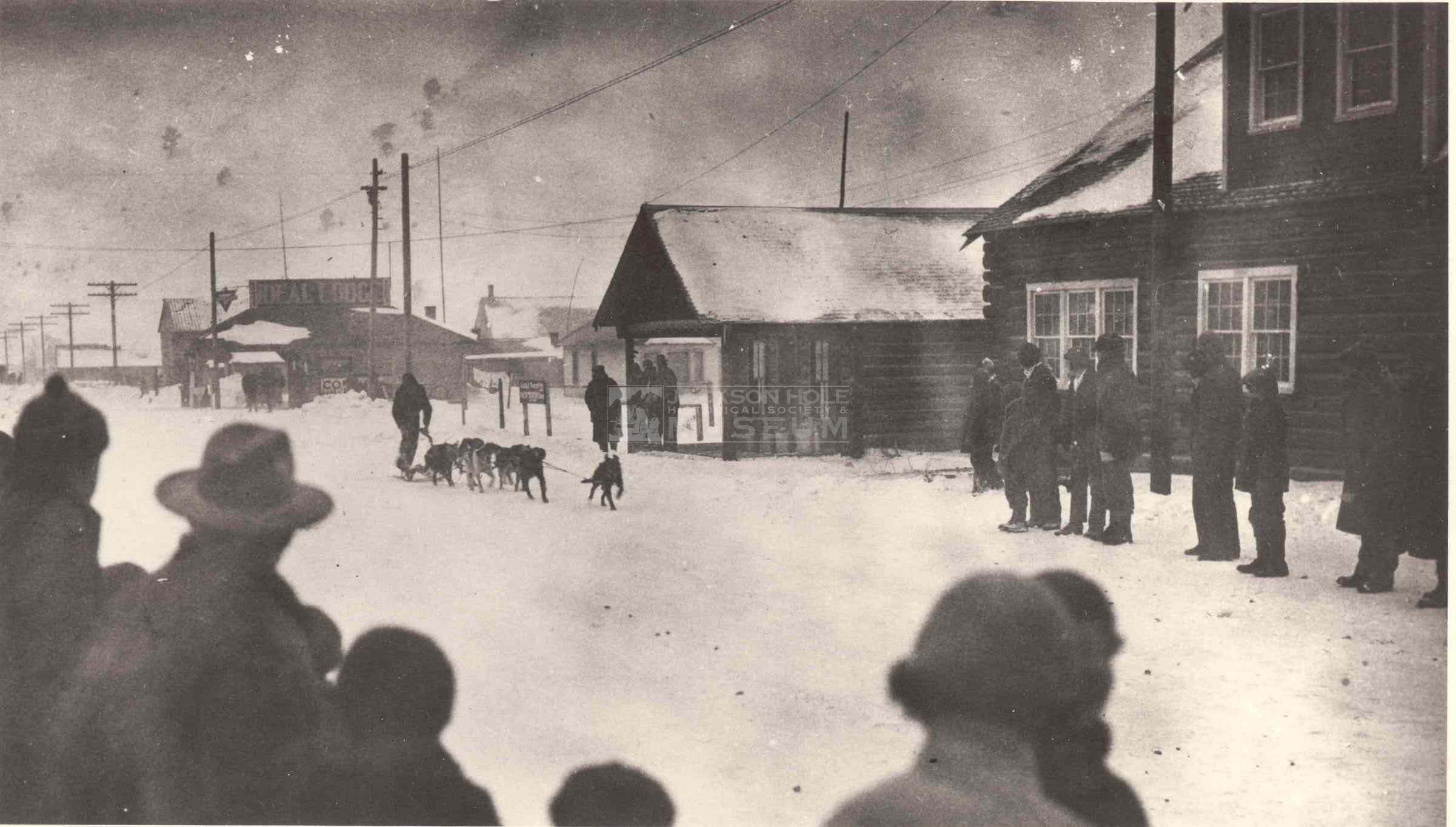 In The Late 20's After George Lamb Had Moved His Family Into The Town,  George Was Challenged To A Dog Sled Race By Frank Van Lewen Frank Had A  Team Of Five