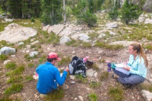 Matt Stirn and Megan Jones record a prehistoric site in thenorthern Tetons.