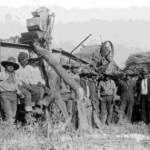 153. Men and threshing equipment