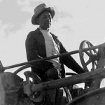 154. Man driving threshing equipment