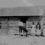 158. Family with dog outside cabin