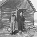 162. Man and woman outside of cabin