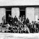 186. Boys and Girls outside old Government School on trout Creek – note bars on windows