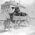 188. Woman in wagon outside of Government School