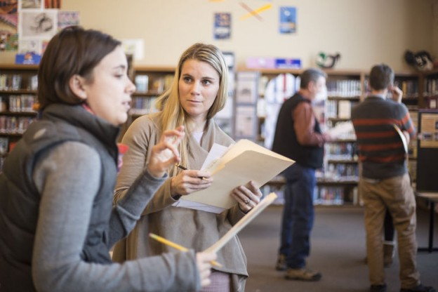 Carin Larkin, right, a Jackson Hole High School English teacher, goes over a student's presentation with Rebecca Sgouros, of the Jackson Hole Historical Society and Museum.