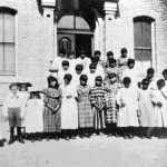 29. Shoshone girls in front of Robert's Mission (white children on left are Rev. Roberts')