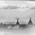 "75. ""ARAPHAOE VILLAGE WYO"" tipis – San dance lodge in background"