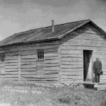 83. Old Mission Chapel, Ft. Washakie, Wyo – Rev Roberts standing by cabin door (now on Sacajawea Cemetery