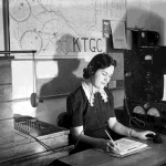 85. Woman working at KTGC switchboard or radio station