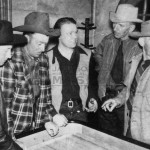 Early rodeo operator Walt Callahan (far left) with buddies on the craps table at the Silver Dollar Bar