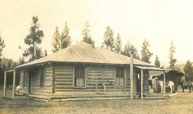 The implement shed was constructed in 1940 by the Jackson Hole Preserve, Inc. (formerly the Snake River Land Company). This wood frame building originally had an ell that would have made it L-shaped, but this was removed in 1959. The sliding door that covered this opening is missing. The shed was built during a period of expansion of the Elk Ranch under John D. Rockefeller Jr.'s management. He was providing the ranch with much-needed upgrades, which included the Uhl Reservoir. The reservoir is fed by Spread Creek and provided the ranch with an exceedingly valuable resource. Special note was taken in the next few years that despite having a drought, the reservoir had enough water to continue to irrigate the hay fields. This was important - the fields were supplying both the Elk Refuge in Jackson and Rockefeller's planned Jackson Hole Wildlife Park near Moran, as well cattle and horses that wintered at the ranch. 	Due to its advantageous location, excellent soil and water sources, the Elk Ranch was allowed to continue operations after its purchase by the Snake River Land Company. The ranch wasn't considered to be in a prime natural area, or blocking mountain views so it was allowed to stay. An additional reason it was allowed to continue was the fact that the land had already been changed considerable due to the continued ranching activities and irrigation. The State of Wyoming required landowners with water rights to continue to use them or they were considered forfeited. Rockefeller recognized the ranch as a highly valuable economic resource for both the valley and the state and worked to keep it functional.