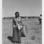 Arapaho man with drum