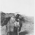 Woman Bringing Firewood