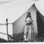Woman outside of tent