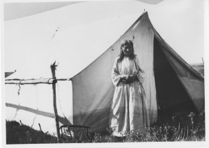 Woman standing outside of Wall Tent