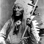 133. Washakie formal portrait with pipe and war bonnet