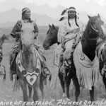 "172. ""Pride of the Tribe"" Pioneer Days Lander 4 women on horses with elk tooth dresses and beaded breast collars etc. for horses"
