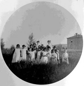183. Shoshone girls and teacher outside Roberts Mission