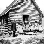 184. Rev. Roberts and school girls outside chapel at Roberts' Mission