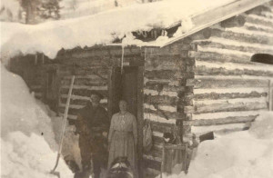 Jackson Hole homesteaders (unidentified) at their cabin in the winter.
