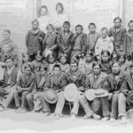 53. Rev. Sherman Coolidge (Arapaho) with students at the first Government School on Trout Creek
