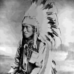 """63. """"James Tasian (Shoshone) J.E. Stimson Cheyenne, Wyo.""""  In war bonnet"""