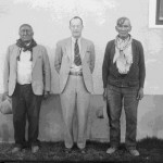 102. Two Indians and white man in front of building