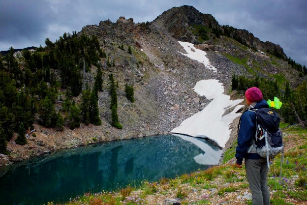 Rebecca Sgouros surveys an alpine lake in the northern Tetons
