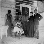 112. Washakie sitting on porch with white baby on lap