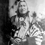 116. Washakie portrait with pipe blanket and beaded shoulder sash showing morning star